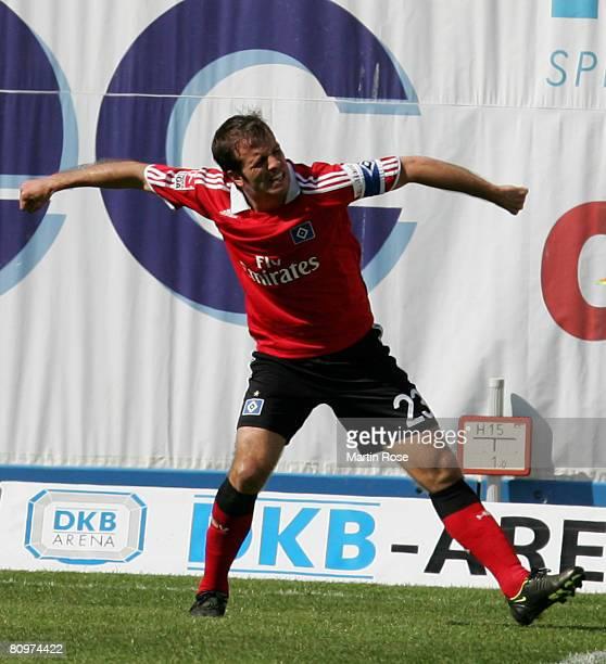Rafael van der Vaart of Hamburg celebrates after scoring the 2nd goal during the Bundesliga match between Hansa Rostock and Hamburger SV at the DKB...
