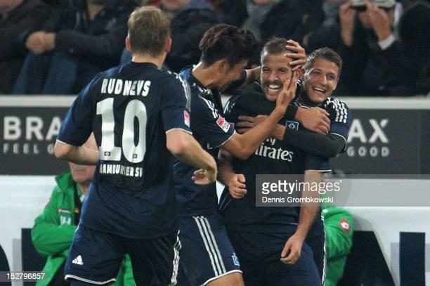 Rafael van der Vaart of Hamburg celebrates with teammates after scoring his team's first goal during the Bundesliga match between Borussia...