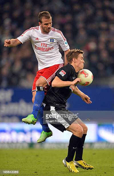 Rafael van der Vaart of Hamburg challenges for the ball with Max Kruse of Freiburg during the Bundesliga match between Hamburger SV and SC Freiburg...