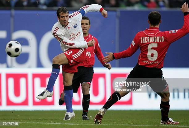 Rafael van der Vaart of Hamburg fights for the ball with Altin Lala and Steven Cherundolo of Hannover during the Bundesliga match between Hamburger...