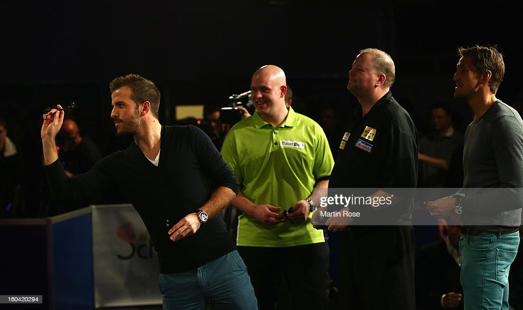 Rafael van der vaart of Hamburg in action during a dart show tournament at between team Netherlands and Hamburger SV at Imtech Arena on January 31, 2013 in Hamburg, Germany.