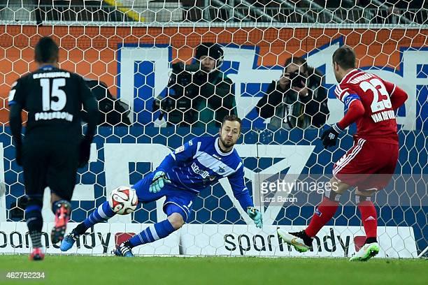 Rafael van der Vaart of Hamburg scores the opening goal with a penalty against Lukas Kruse keeper of Paderborn during the Bundesliga match between SC...