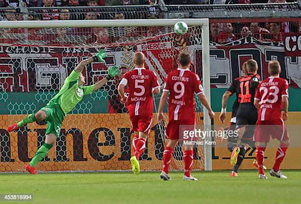 Rafael van der Vaart of Hamburg scores the third goal during the DFB Cup match between FC Energie Cottbus and Hamburger SV at Stadion der...