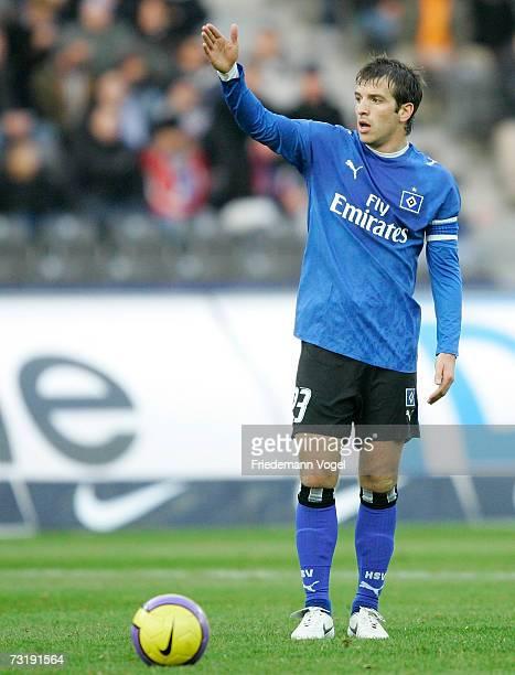 Rafael van der Vaart of Hamburg signals to his players during the Bundesliga match between Hertha BSC Berlin and Hamburger SV at the Olympic stadium...