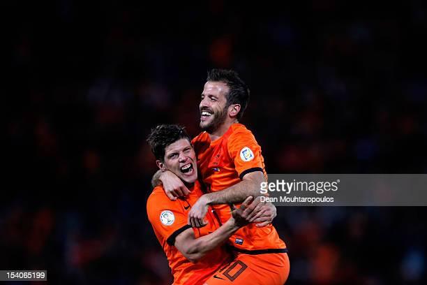 Rafael Van der Vaart of Netherlands celebrates with team mate KlaasJan Huntelaar after scoring the first goal of the game during the FIFA 2014 World...