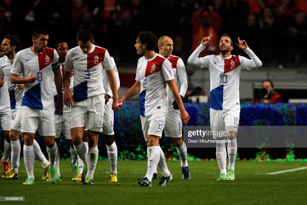 Rafael Van der Vaart (#10) of Netherlands celebrates with team mates after scoring the first goal of the game during the the Group 4 FIFA 2014 World Cup Qualifier match between Netherlands and Romania at Amsterdam Arena on March 26, 2013 in Amsterdam, Netherlands.