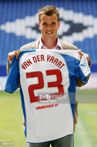 Rafael Van der Vaart of Netherlands poses holding his new jersey during the Press Conference of Hamburg SV on June 7, 2005 in Hamburg, Germany. He...