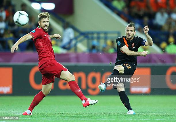Rafael van der Vaart of Netherlands scores the opening goal past Miguel Veloso of Portugal during the UEFA EURO 2012 group B match between Portugal...