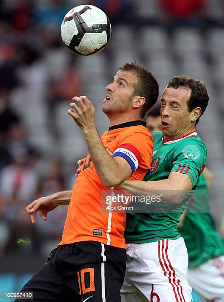 Rafael van der Vaart of the Netherlands is challenged by Gerardo Torrado of Mexico during the international friendly match between the Netherlands...