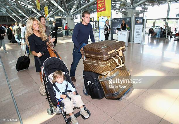 Rafael van der Vaart poses with his wife Sylvie and son Damian at the Hamburg Airport on August 4 2008 in Hamburg Germany Rafael van der Vaart plays...