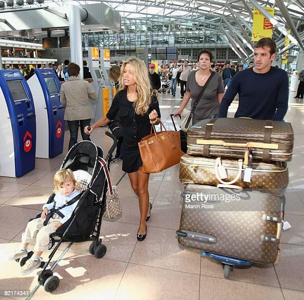 Rafael van der Vaart walks with his wife Sylvie and son Damian at the Hamburg Airport on August 4 2008 in Hamburg Germany Rafael van der Vaart plays...