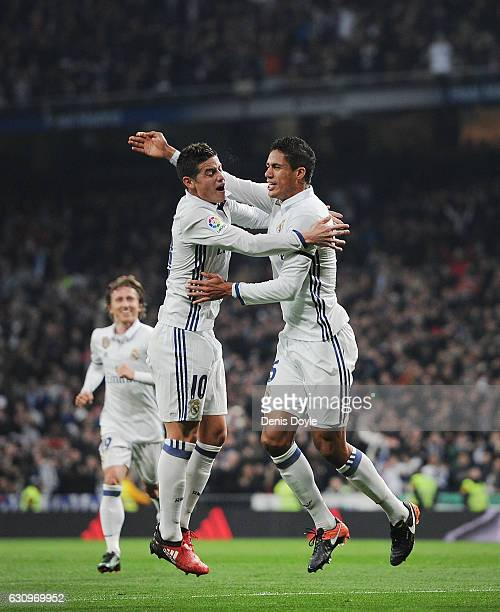 Rafael Varane of Real Madrid celebrates with James Rodriguez after scoring Real's 2nd goal during the Copa del Rey Round of 16 First Leg match...