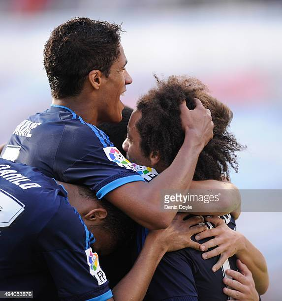 Rafael Varane of Real Madrid celebrates with Marcelo after Marcelo scored Real's 3rd goal during the La Liga match between Celta Vigo and Real Madrid...