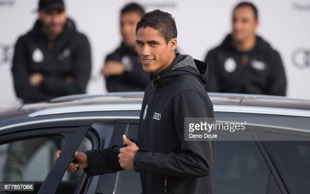 Rafael Varane of Real Madrid CF poses for a photograph after being presented with a new Audi car as part of an ongoing sponsorship deal with Real...