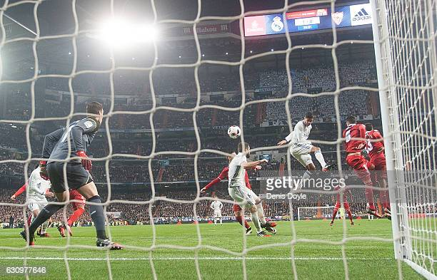 Rafael Varane of Real Madrid heads home Real's 2nd goal during the Copa del Rey Round of 16 First Leg match between Real Madrid and Sevilla at...