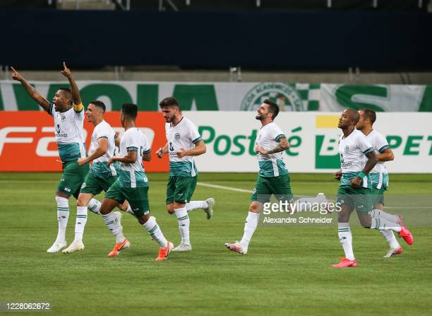Rafael Vaz of Goias celebrates with his teammates after scoring the first goal of his team during the match between Palmeiras and Goias as part of...