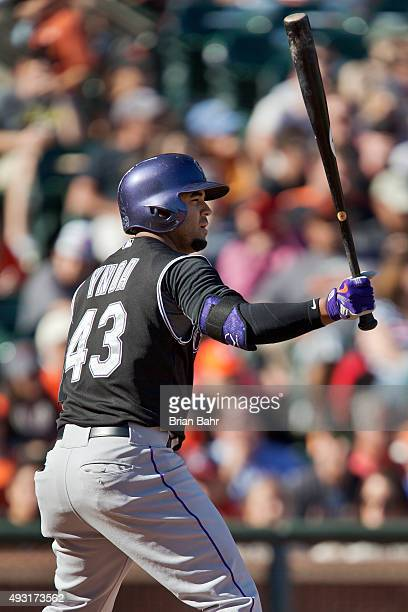Rafael Ynoa of the Colorado Rockies pinch hits for a single against the San Francisco Giants in the seventh inning at AT&T Park on October 3, 2015 in...