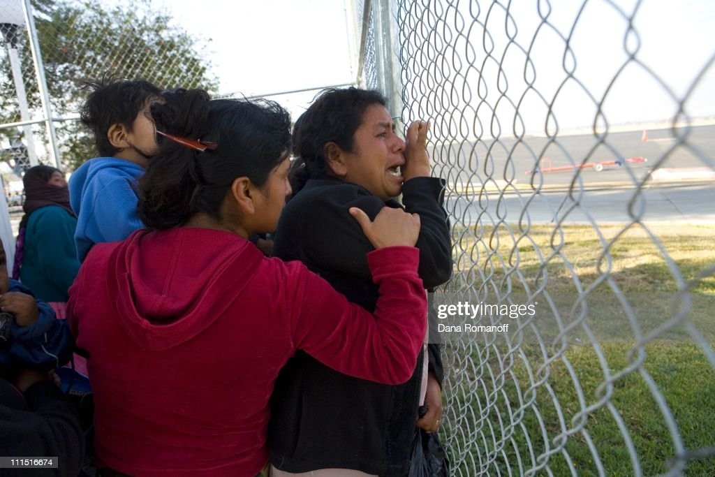 Rafaela Cruz Cruz cries as she watches her son Celso, age 13, board a plane to Tijuana where he will attempt to illegally cross the border on February 21, 2008 in Oaxaca. Rafaela is surrounded by other mothers, sisters and wives whose men are leaving in search of work in the United States. The women are sad to see their men go but they know that this is their only hope to have enough money to provide for their family.
