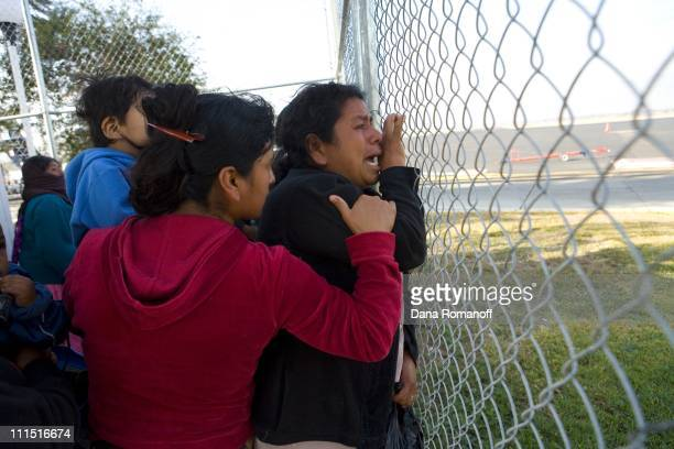 Rafaela Cruz Cruz cries as she watches her son Celso age 13 board a plane to Tijuana where he will attempt to illegally cross the border on February...