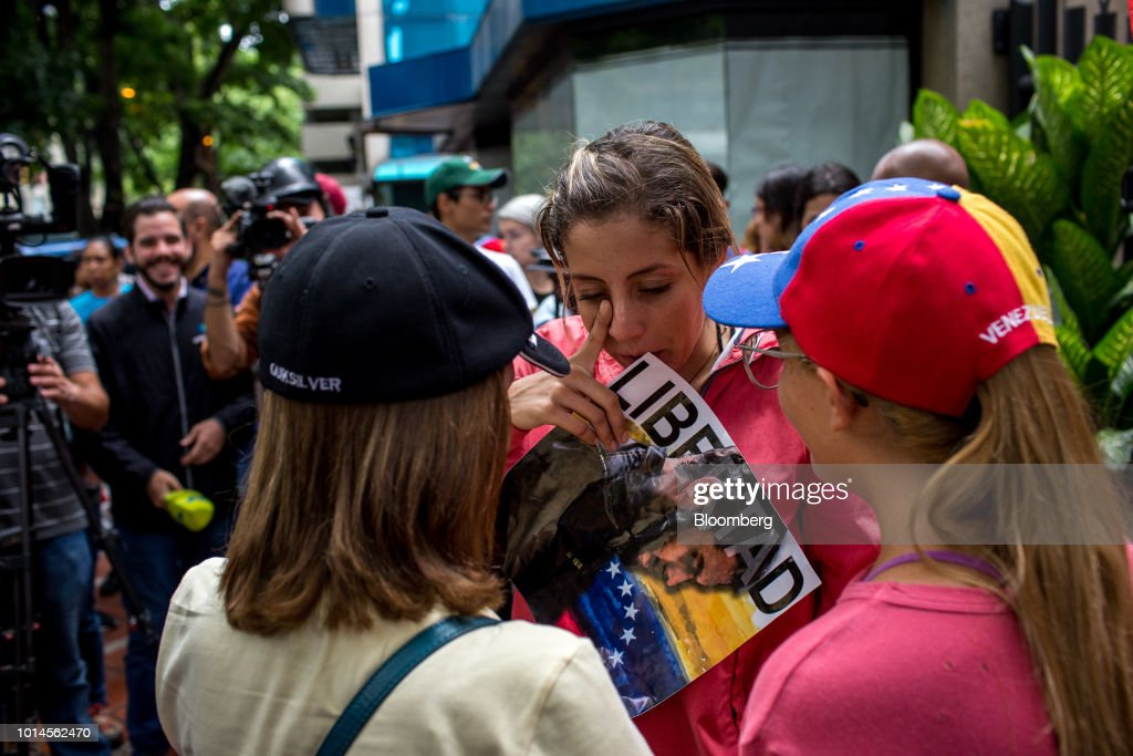 Rafaela Requesens, sister of detained congressman Juan Requesens, center, reacts during a protest in front of the Organization of American States (OAS) headquarters in Caracas, Venezuela, on Friday, Aug. 10, 2018. Venezuelan President Nicolas Maduro launched a roundup of opponents in tandem with a security sweep in the wake of Saturday's explosive drone attack. Requesens was arrested by intelligence police Tuesday evening and taken from his his east Caracas apartment, security camera footage showed. Photographer: Manaure Quintero/Bloomberg via Getty Images