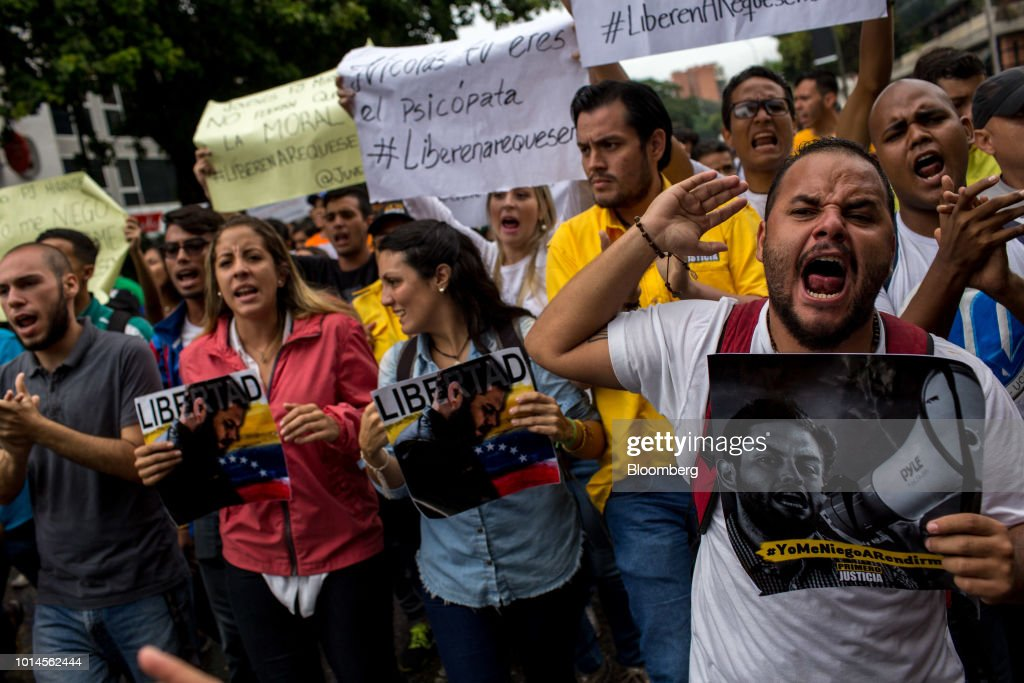 Rafaela Requesens, sister of detained congressman Juan Requesens, second right, and demonstrators shout slogans during a protest in front of the Organization of American States (OAS) headquarters in Caracas, Venezuela, on Friday, Aug. 10, 2018. Venezuelan President Nicolas Maduro launched a roundup of opponents in tandem with a security sweep in the wake of Saturday's explosive drone attack. Requesens was arrested by intelligence police Tuesday evening and taken from his his east Caracas apartment, security camera footage showed. Photographer: Manaure Quintero/Bloomberg via Getty Images
