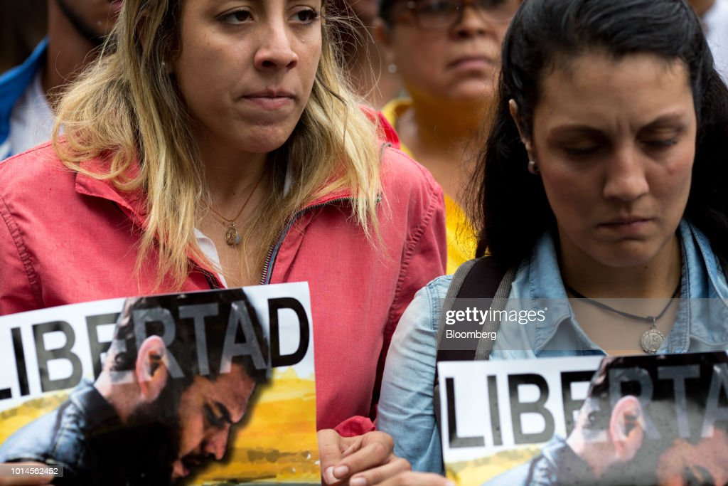 Rafaela Requesens, sister of detained congressman Juan Requesens, left, holds a sign during a protest in front of the Organization of American States (OAS) headquarters in Caracas, Venezuela, on Friday, Aug. 10, 2018. Venezuelan President Nicolas Maduro launched a roundup of opponents in tandem with a security sweep in the wake of Saturday's explosive drone attack. Requesens was arrested by intelligence police Tuesday evening and taken from his his east Caracas apartment, security camera footage showed. Photographer: Manaure Quintero/Bloomberg via Getty Images
