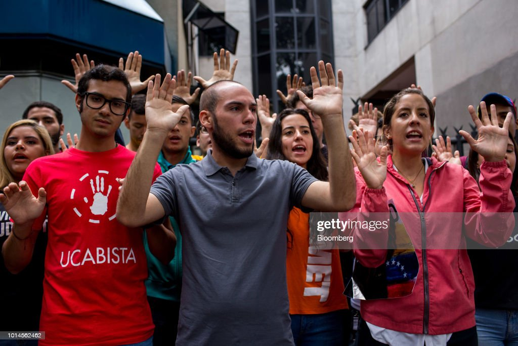 Rafaela Requesens, sister of detained congressman Juan Requesens, right, and demonstrators shout slogans during a protest in front of the Organization of American States (OAS) headquarters in Caracas, Venezuela, on Friday, Aug. 10, 2018. Venezuelan President Nicolas Maduro launched a roundup of opponents in tandem with a security sweep in the wake of Saturday's explosive drone attack. Requesens was arrested by intelligence police Tuesday evening and taken from his his east Caracas apartment, security camera footage showed. Photographer: Manaure Quintero/Bloomberg via Getty Images