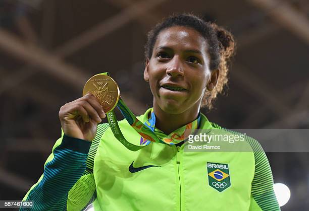 Rafaela Silva of Brazil celebrates after winning the gold medal in the Women's 57 kg Final Gold Medal Contest on Day 3 of the Rio 2016 Olympic Games...