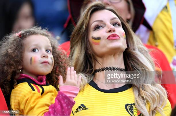 Rafaella Szabo the wife of Axel Witsel of Belgium and her daughter attend the 2018 FIFA World Cup Russia Semi Final match between Belgium and France...