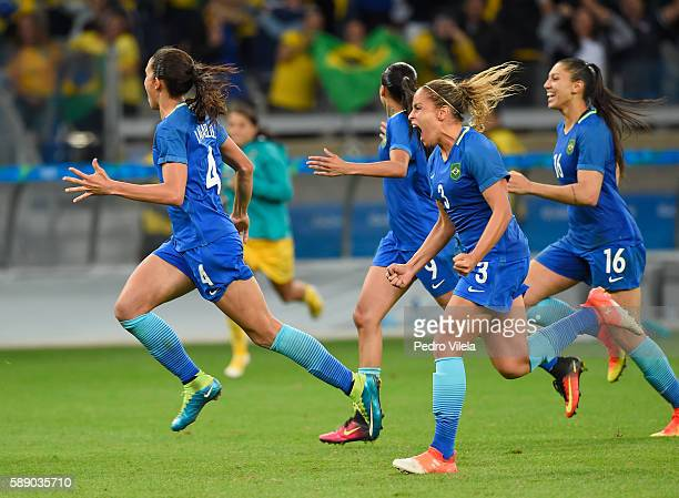 Rafaelle Monica Beatriz and Andressa Alves of Brazil celebrate their 00 win over Australia during the Women's Football Quarterfinal match at Mineirao...