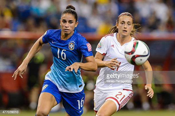 Rafaelle of Brazil and Alexia Putellas of Spain chase the ball during the 2015 FIFA Women's World Cup Group E match at Olympic Stadium on June 13...