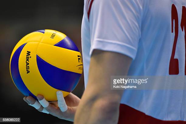 Rafal Buszek of Poland hands a ball during the Men's World Olympic Qualification game between Poland and Iran at Tokyo Metropolitan Gymnasium on June...