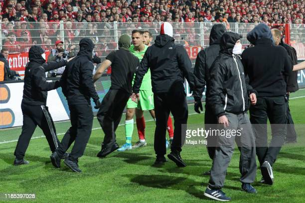 Rafal Gikiewicz of 1.FC Union Berlin tell his fans to leave the pitch after the Bundesliga match between 1. FC Union Berlin and Hertha BSC at Stadion...