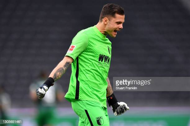 Rafal Gikiewicz of FC Augsburg celebrates after teammate Laszlo Benes scores their side's first goal during the Bundesliga match between Hertha BSC...