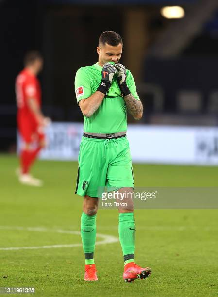 Rafal Gikiewicz of FC Augsburg reacts after the Bundesliga match between FC Schalke 04 and FC Augsburg at Veltins-Arena on April 11, 2021 in...