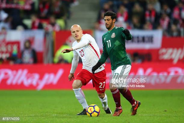 Rafal Kurzawa of Poland in action with Jose de Jesus Corona of Mexico during the international friendly match between Poland and Mexico on November...