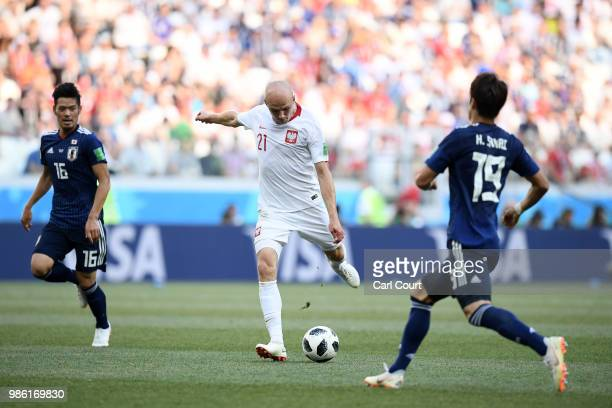 Rafal Kurzawa of Poland takes a shot past Hiroki Sakai of Japan during the 2018 FIFA World Cup Russia group H match between Japan and Poland at...