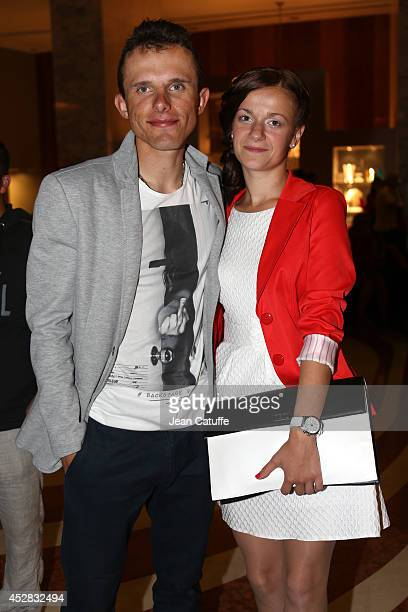 Rafal Majka of Poland and Tinkoff-Saxo and his girlfriend leave their hotel on their way to the riders' party after the twenty one and last stage of...