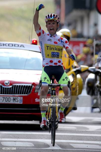 Rafal Majka of Poland and TinkoffSaxo celebrates as he wins the seventeenth stage and defends the king of the mountains polka dot jersey in the 2014...
