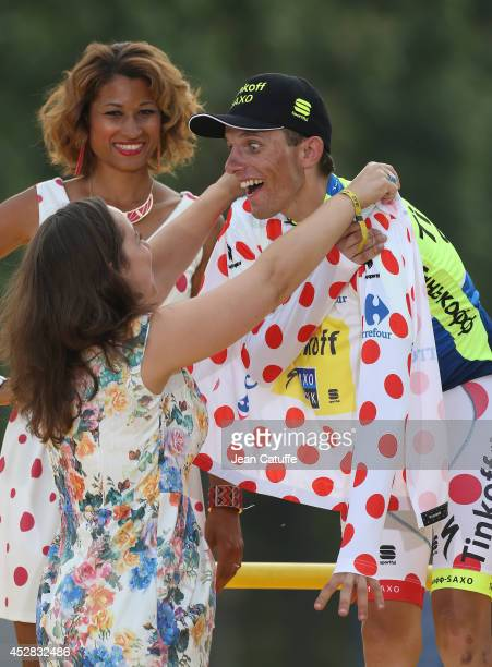 Rafal Majka of Poland and Tinkoff-Saxo receives the best climber's jersey on the podium after the twenty one and last stage of the 2014 Tour de...