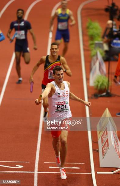 Rafal Omelko of Poland celebrates as he crosses the finish line to win the gold medal for his team in the Men's 4x400 metres relay final on day three...