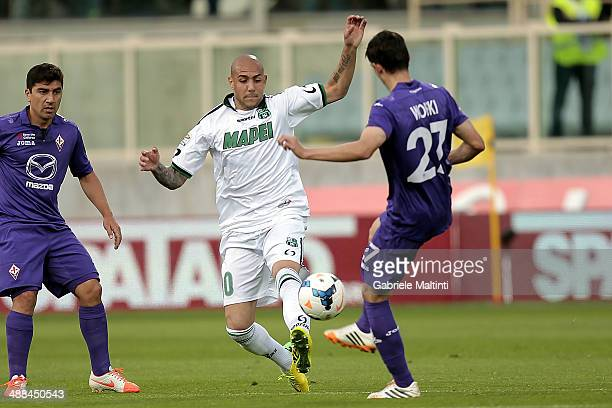 Rafal Wolski of ACF Fiorentina fights for the ball with Simone Zaza of US Sassuolo Calcio during the Serie A match between ACF Fiorentina and US...