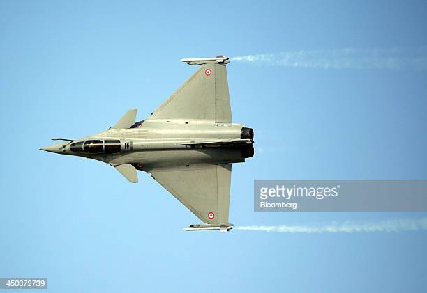 A Rafale fighter jet manufactured by Dassault Aviation SA is seen performing an air display at the 13th Dubai Airshow at Dubai World Central in Dubai...