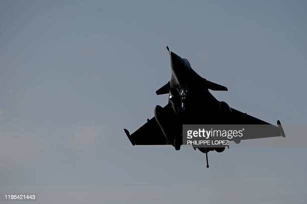 A Rafale jet fighter lands on the French aircraft carrier Charles de Gaulle at sea off the coast of the city of Hyeres on January 23 2020