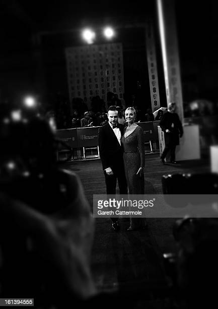Rafe Spall and Elize du Toit attend the EE British Academy Film Awards at The Royal Opera House on February 10 2013 in London England