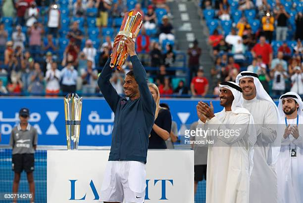 Rafeal Nadal of Spain lifts the trophy after victory against David Goffin of Belgium during the Mubadala World Tennis Championship at Zayed Sport...