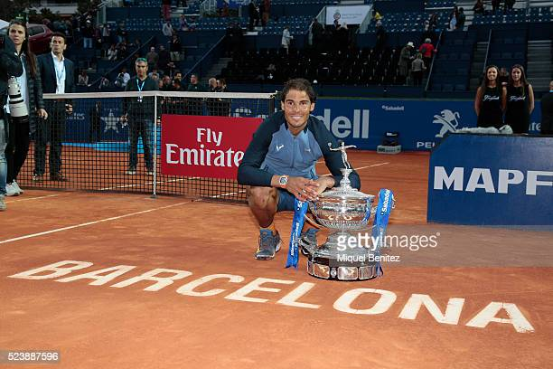Rafel Nadal poses with the trophy after defeating Kei Nishikori of Japan in their final match during the Barcelona Open Banc Sabadell at the real...