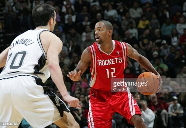 Rafer Alston of the Houston Rockets looks to pass against Manu Ginobili of the San Antonio Spurs at the ATT Center January 24 2007 in San Antonio...