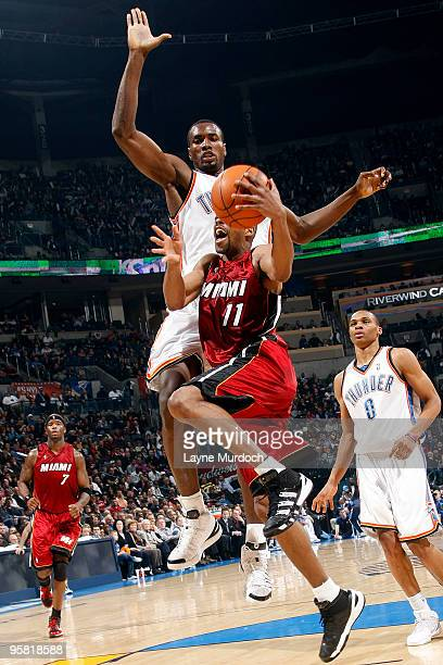 Rafer Alston of the Miami Heat attempts to shoot a layup against Serge Ibaka of the Oklahoma City Thunder on January 16 2010 at the Ford Center in...