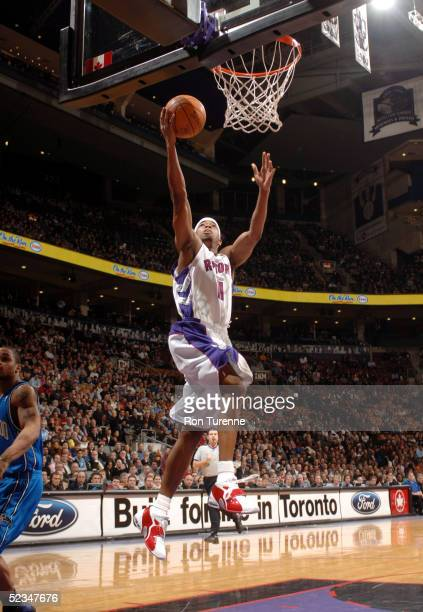 Rafer Alston of the Toronto Raptors completes the fastbreak with a layup against the Orlando Magic on March 9 2005 at the Air Canada Centre in...